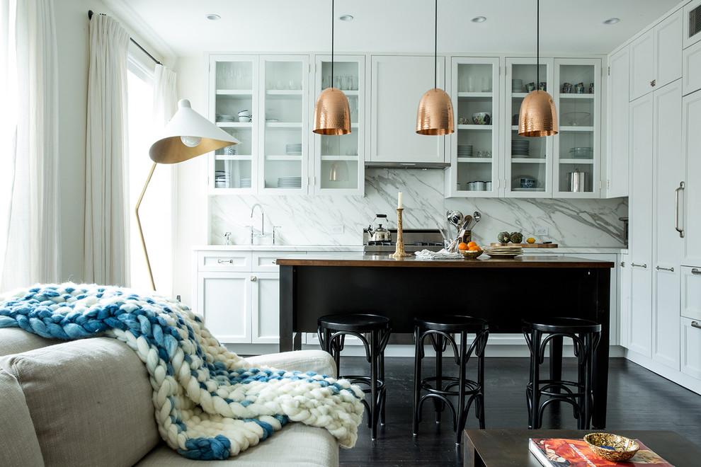 Open concept kitchen - mid-sized transitional l-shaped dark wood floor open concept kitchen idea in New York with shaker cabinets, white cabinets, stainless steel appliances, an island, an undermount sink, wood countertops, white backsplash and marble backsplash