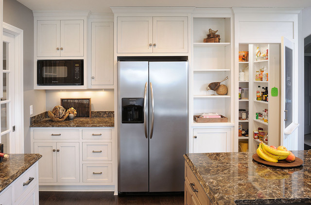 Example Of A Classic Kitchen Design In Cleveland With Shaker Cabinets,  White Cabinets And Stainless