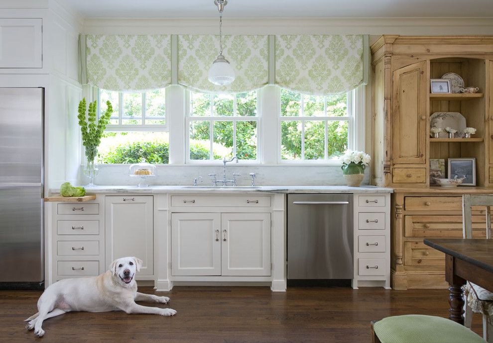 Inspiration for a timeless kitchen remodel in Charlotte with stainless steel appliances, recessed-panel cabinets and white cabinets