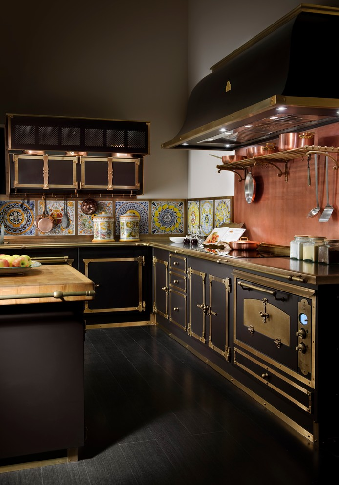 Inspiration for a victorian black floor kitchen remodel in New York with black appliances
