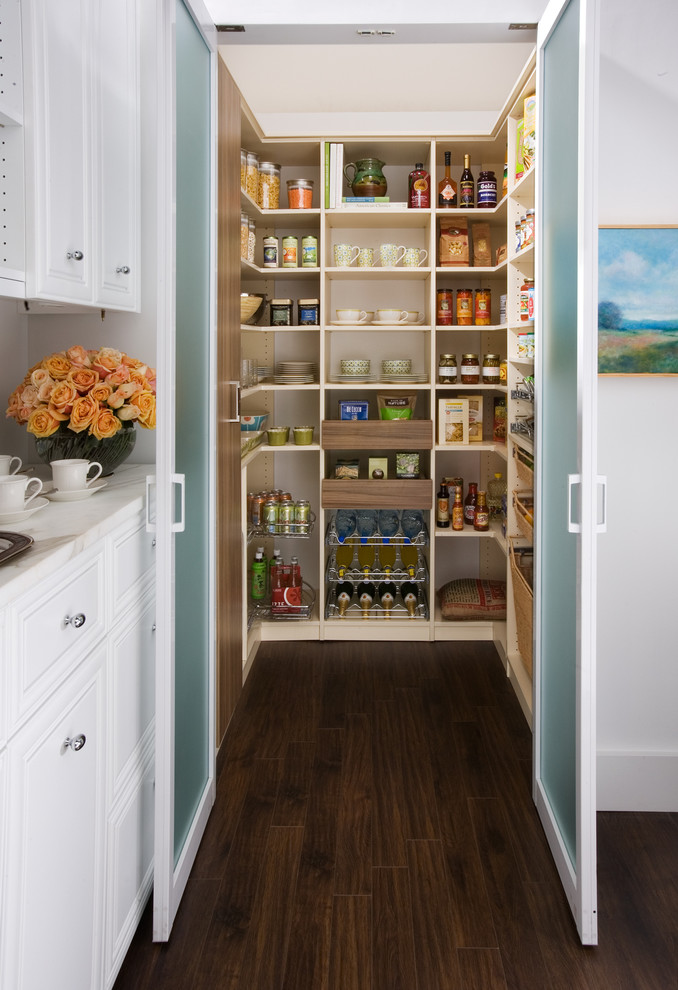 Example of a large classic dark wood floor kitchen pantry design in New York with white cabinets, open cabinets, marble countertops, white backsplash and no island