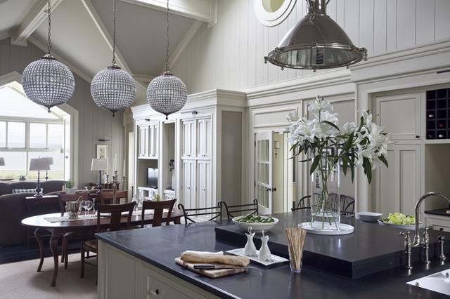 Huge elegant u-shaped dark wood floor open concept kitchen photo in Dublin with a double-bowl sink, recessed-panel cabinets, granite countertops, gray backsplash, subway tile backsplash and an island