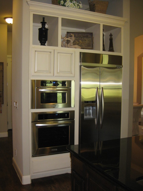 Wall Ovens Next To Refrigerator In Kitchen By Burrows