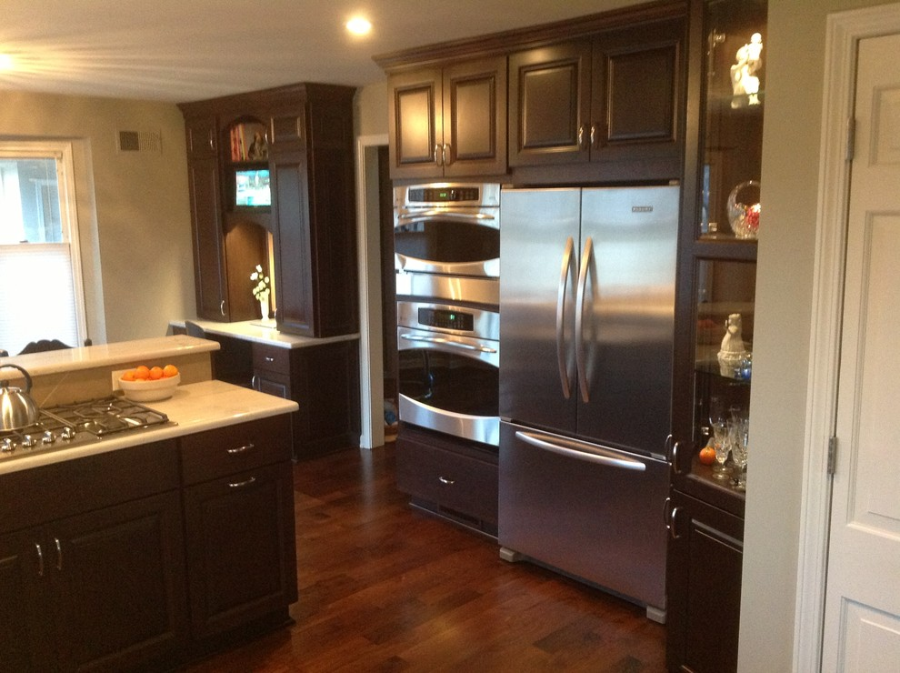 Walnut Cabinets with Stainless steel appliances ...