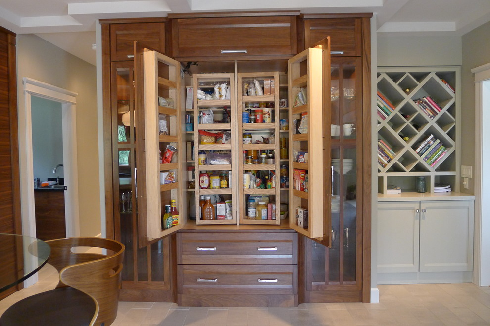 Inspiration for a contemporary u-shaped kitchen pantry remodel in Indianapolis with soapstone countertops, medium tone wood cabinets, glass tile backsplash and stainless steel appliances