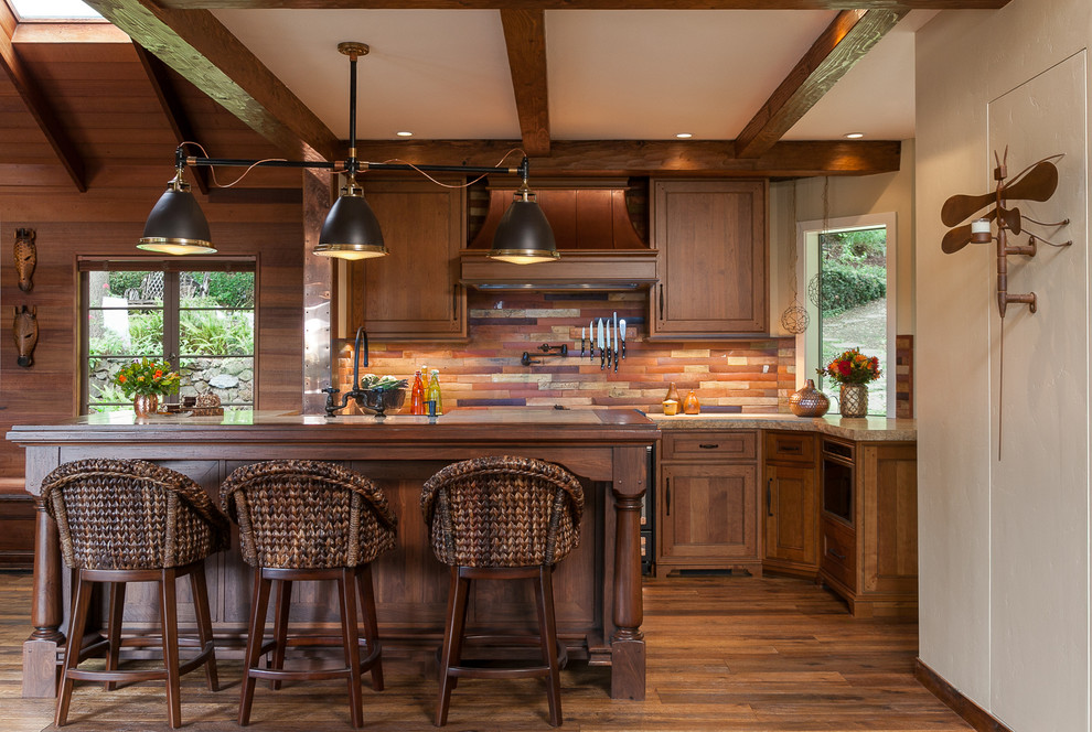 Example of a mid-sized mountain style galley dark wood floor kitchen design in San Francisco with shaker cabinets, dark wood cabinets, an island, slate backsplash and granite countertops