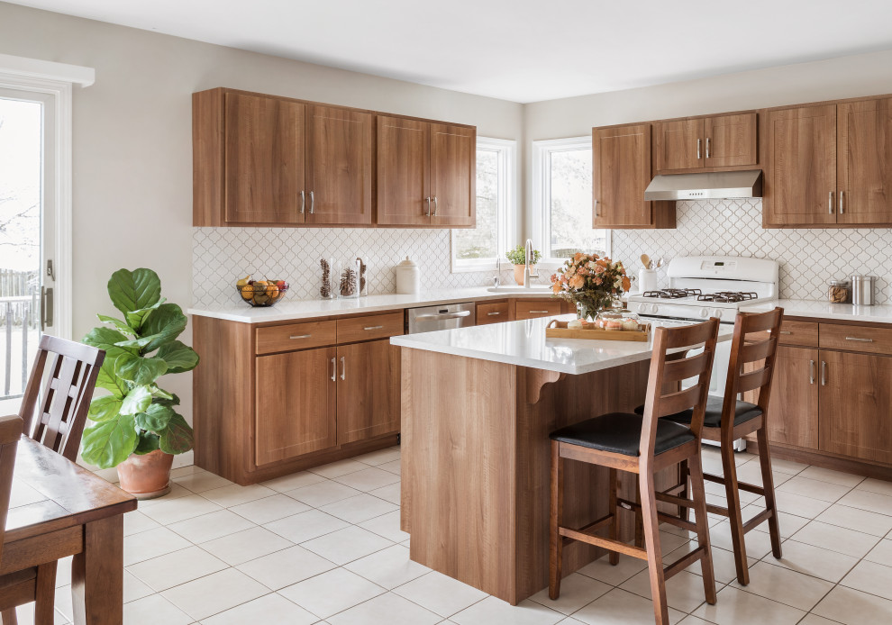 Eat-in kitchen - large transitional l-shaped cement tile floor and white floor eat-in kitchen idea in Other with a single-bowl sink, flat-panel cabinets, medium tone wood cabinets, quartzite countertops, white backsplash, ceramic backsplash, stainless steel appliances, an island and white countertops