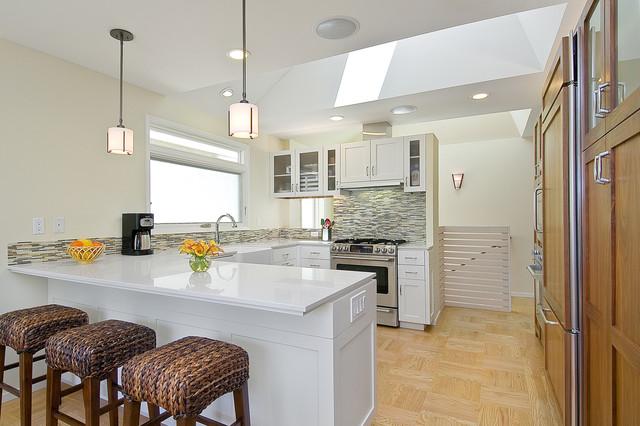 Inspiration for a contemporary u-shaped kitchen remodel in San Francisco  with matchstick tile backsplash