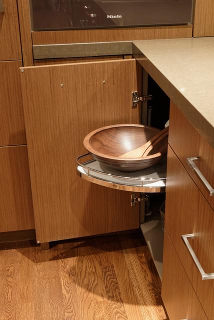 Mid-sized trendy u-shaped medium tone wood floor eat-in kitchen photo in DC Metro with an integrated sink, flat-panel cabinets, medium tone wood cabinets, quartz countertops, stone tile backsplash, paneled appliances, an island and gray backsplash