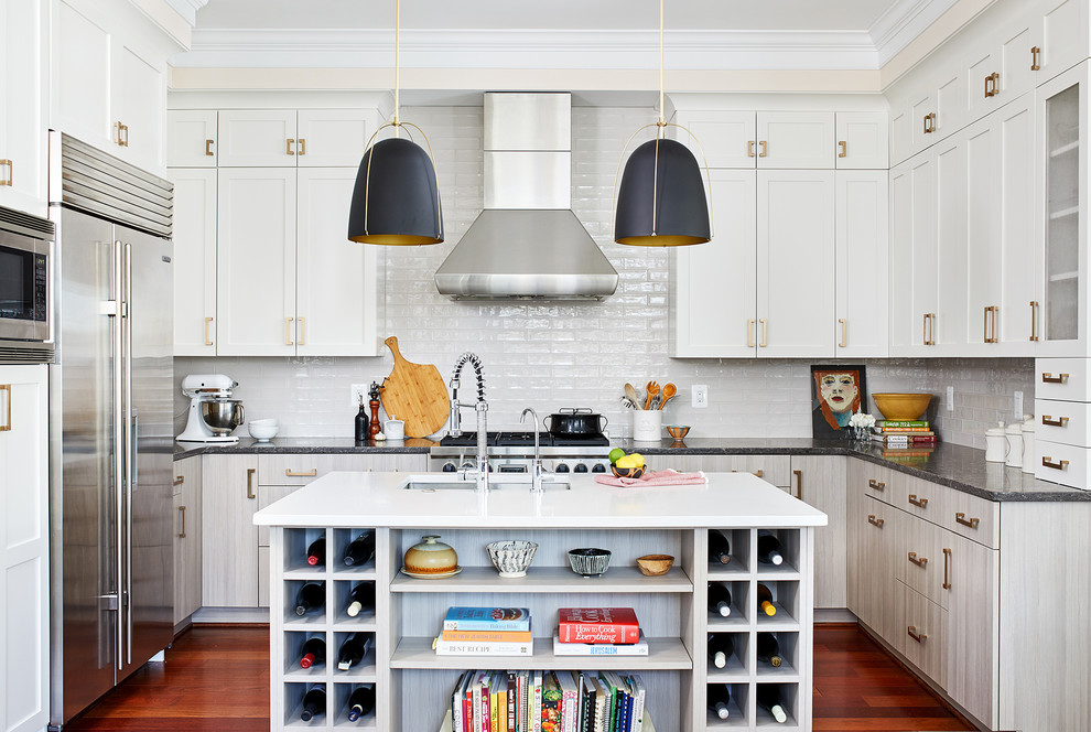 Kitchen - mid-sized transitional u-shaped medium tone wood floor and brown floor kitchen idea in DC Metro with subway tile backsplash, stainless steel appliances, an island, an undermount sink, shaker cabinets, white cabinets, green backsplash and white countertops