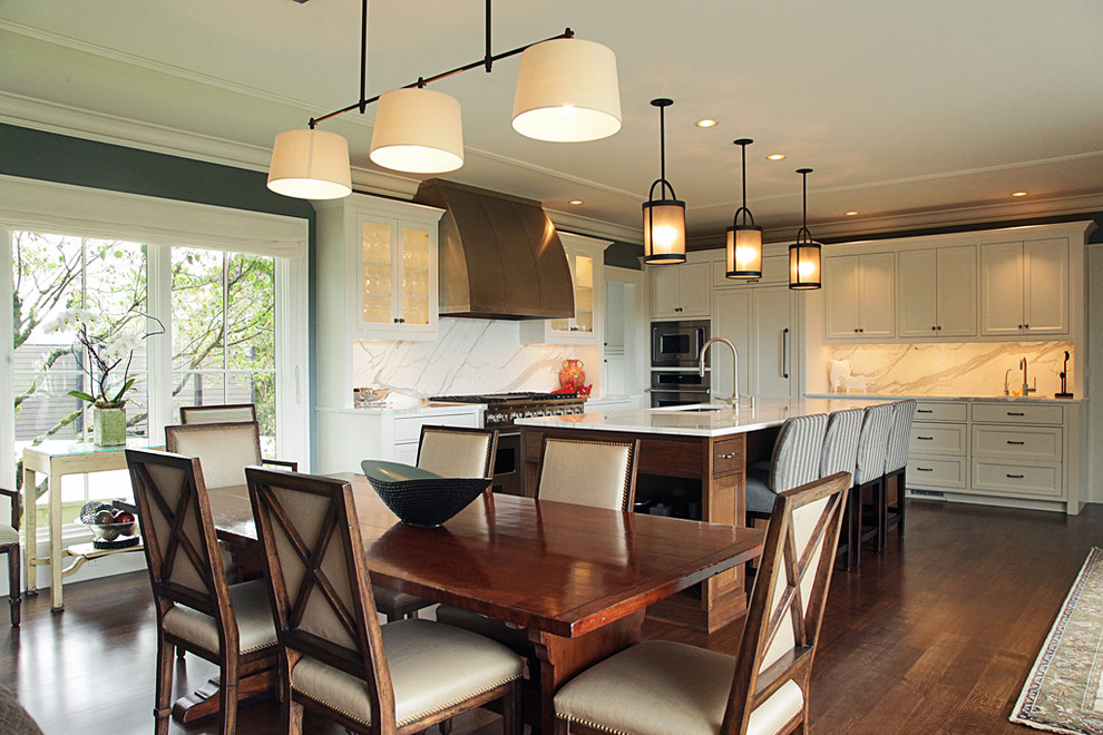 Inspiration for a contemporary eat-in kitchen remodel in Seattle with shaker cabinets, paneled appliances, white cabinets, marble countertops, white backsplash and stone slab backsplash