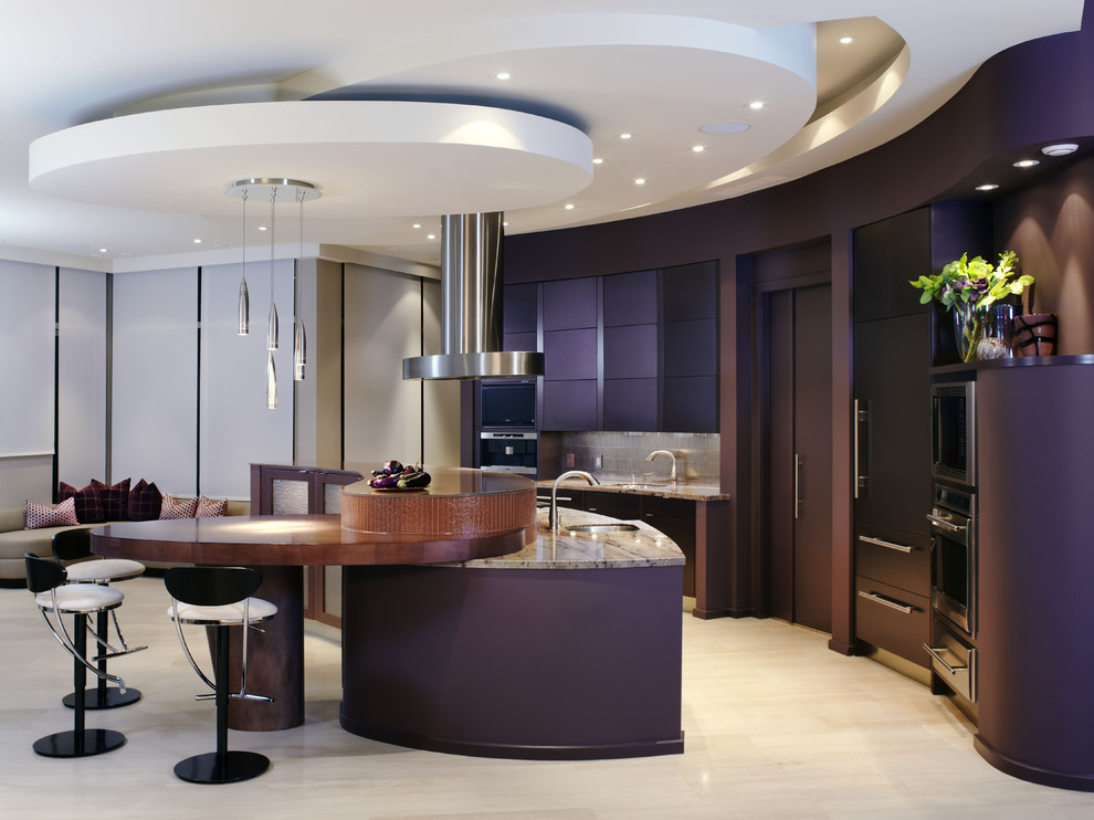 Example of a large trendy galley limestone floor open concept kitchen design in Toronto with granite countertops, an undermount sink, flat-panel cabinets, metallic backsplash, metal backsplash, stainless steel appliances and an island