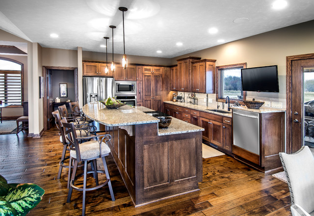 Inspiration for a transitional dark wood floor eat-in kitchen remodel in Other with an undermount sink, dark wood cabinets, granite countertops, stainless steel appliances, an island, beige backsplash, ceramic backsplash and recessed-panel cabinets