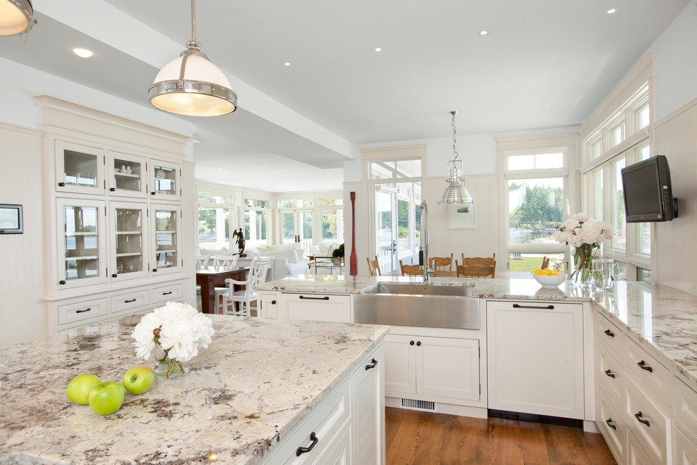 Kitchen - traditional kitchen idea in Vancouver with a farmhouse sink and granite countertops