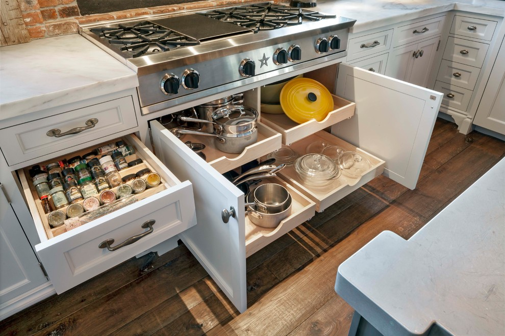 Eat-in kitchen - large eclectic u-shaped medium tone wood floor and brown floor eat-in kitchen idea in Other with glass-front cabinets, an island, white cabinets, granite countertops and brown backsplash