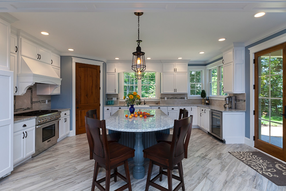 Mid-sized farmhouse u-shaped marble floor eat-in kitchen photo in Grand Rapids with a double-bowl sink, recessed-panel cabinets, white cabinets, marble countertops, gray backsplash, stone tile backsplash, stainless steel appliances and an island
