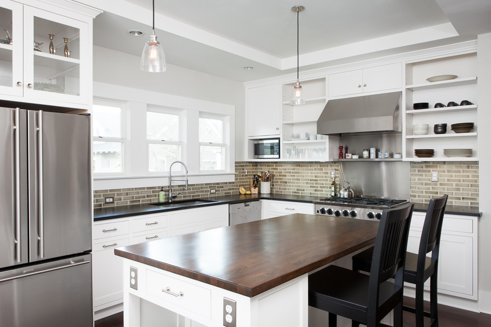 Trendy kitchen photo in Portland with open cabinets, stainless steel appliances, wood countertops, white cabinets, brown backsplash and subway tile backsplash