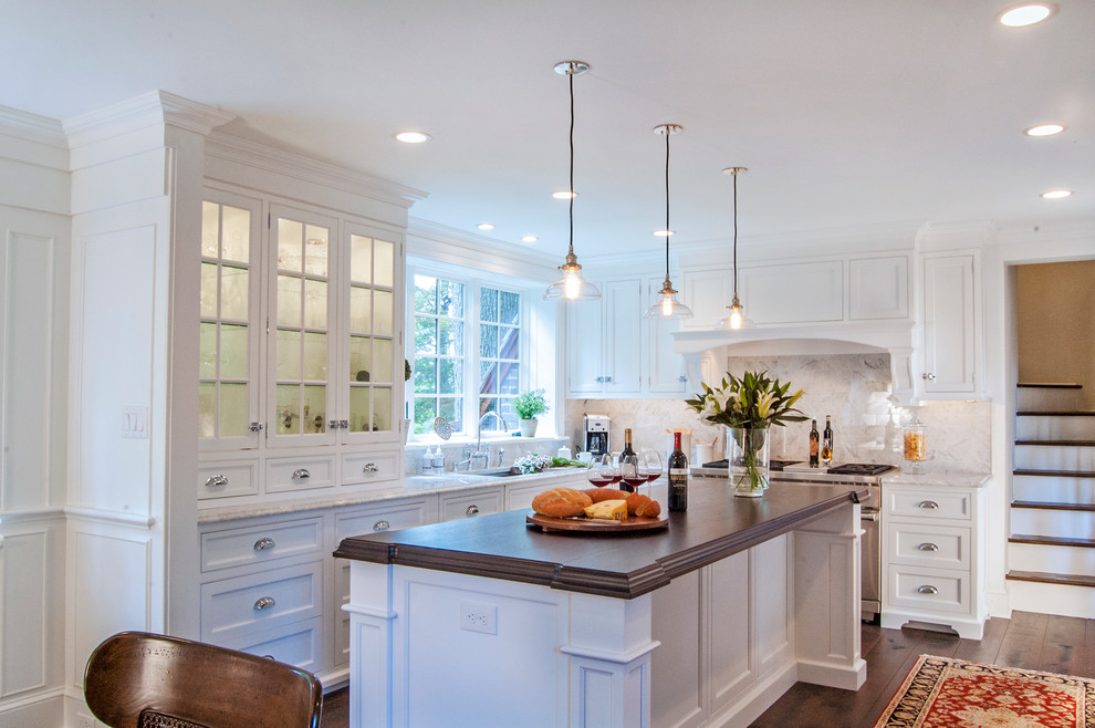Large elegant l-shaped dark wood floor eat-in kitchen photo in Philadelphia with an undermount sink, white cabinets, wood countertops, white backsplash, stone tile backsplash, stainless steel appliances, an island and recessed-panel cabinets