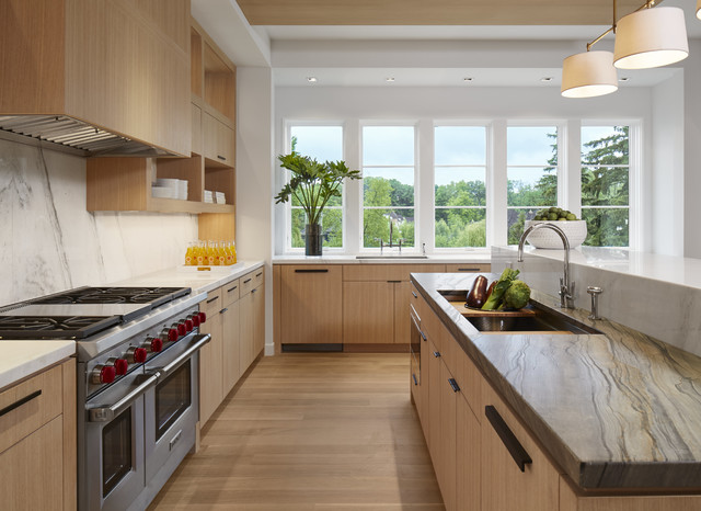 Trendy l-shaped medium tone wood floor kitchen photo in Minneapolis with an undermount sink, flat-panel cabinets, medium tone wood cabinets, white backsplash, stainless steel appliances and an island