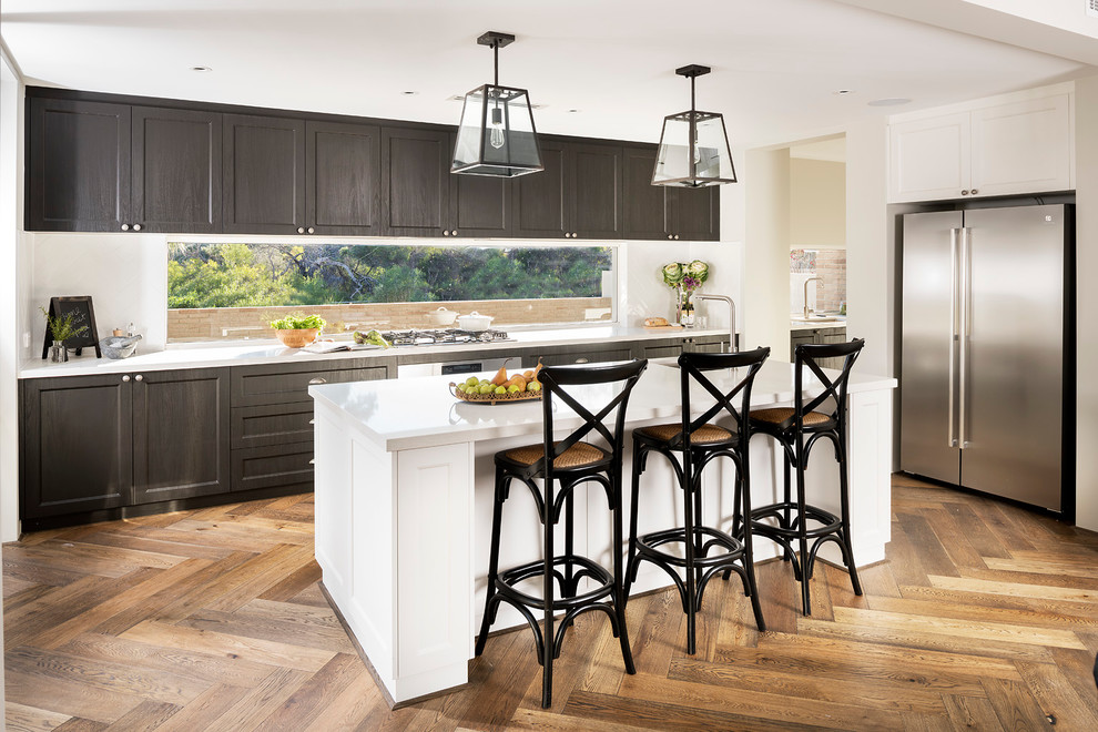 Inspiration for a transitional medium tone wood floor kitchen remodel in Perth with white backsplash, shaker cabinets, dark wood cabinets, matchstick tile backsplash, stainless steel appliances and an island