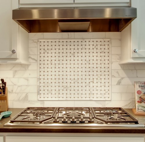 what is the backsplash tile calcutta gold what are the small squares light emperador