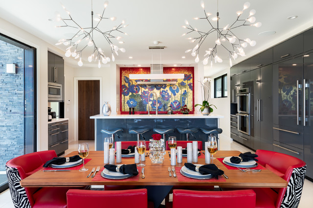 Large minimalist u-shaped white floor eat-in kitchen photo in Hawaii with flat-panel cabinets, gray cabinets, solid surface countertops, an island, white countertops, multicolored backsplash, mosaic tile backsplash and paneled appliances