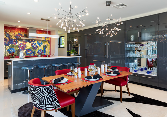 Eat-in kitchen - large modern u-shaped white floor eat-in kitchen idea in Hawaii with flat-panel cabinets, gray cabinets, solid surface countertops, multicolored backsplash, mosaic tile backsplash, paneled appliances, an island and white countertops