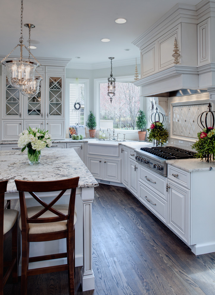 Kitchen - traditional kitchen idea in Chicago with a farmhouse sink, raised-panel cabinets, white cabinets and white countertops