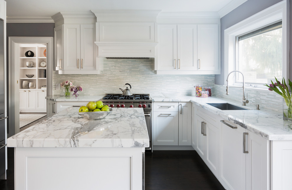 Mid-sized transitional dark wood floor kitchen photo in Toronto with an undermount sink, shaker cabinets, white cabinets, white backsplash, mosaic tile backsplash and stainless steel appliances