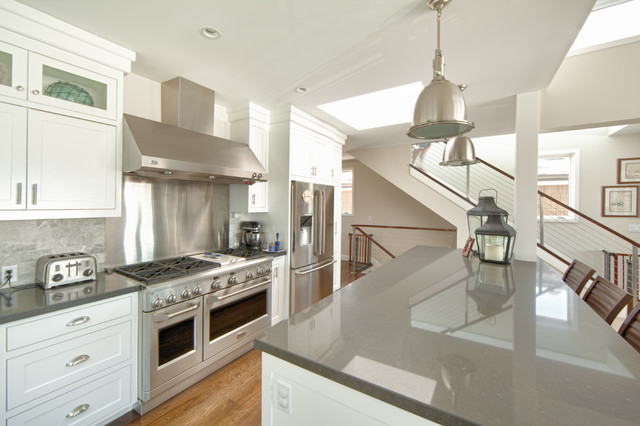 White Kitchen Grey Countertop west bay newport beach - beach style - kitchen - orange county