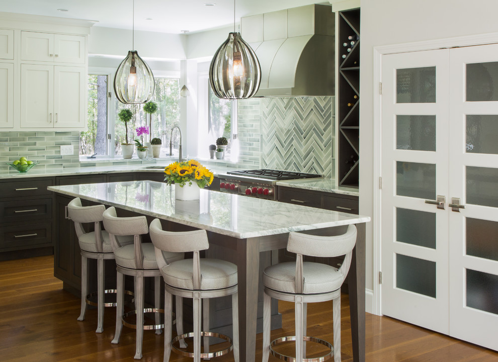 Eat-in kitchen - mid-sized contemporary u-shaped medium tone wood floor and brown floor eat-in kitchen idea in Salt Lake City with an undermount sink, recessed-panel cabinets, white cabinets, marble countertops, stainless steel appliances, an island, white countertops, gray backsplash and ceramic backsplash