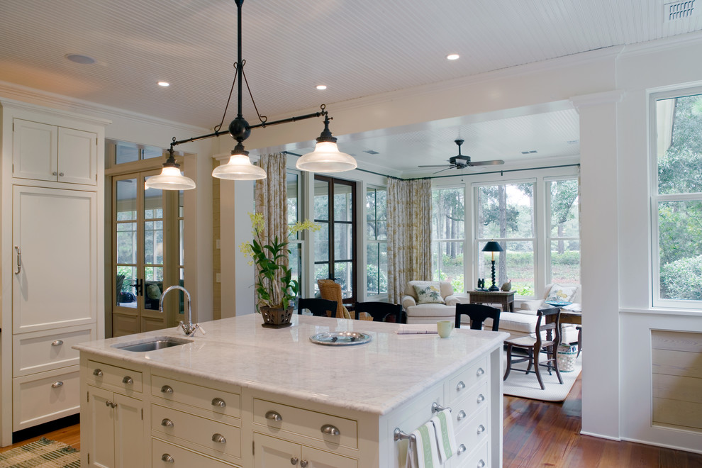 Elegant u-shaped open concept kitchen photo in Atlanta with an undermount sink, beaded inset cabinets, white cabinets and marble countertops