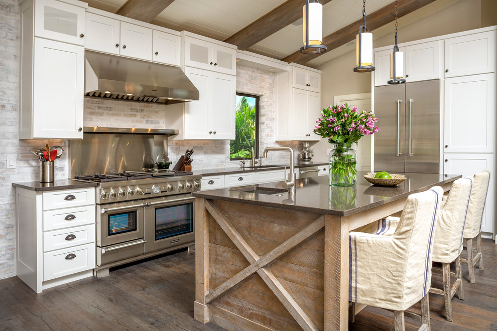 Elegant galley dark wood floor kitchen photo in Tampa with an undermount sink, shaker cabinets, white cabinets, stainless steel appliances and an island