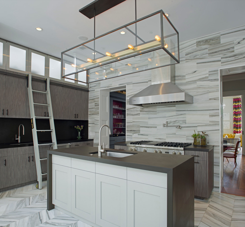 Mid-sized trendy single-wall marble floor and gray floor eat-in kitchen photo in Atlanta with an undermount sink, flat-panel cabinets, gray cabinets, stainless steel appliances, an island, gray backsplash, stone tile backsplash and solid surface countertops