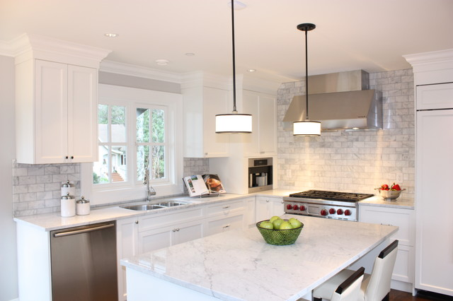 Kitchen - traditional kitchen idea in Vancouver with stainless steel appliances and marble backsplash