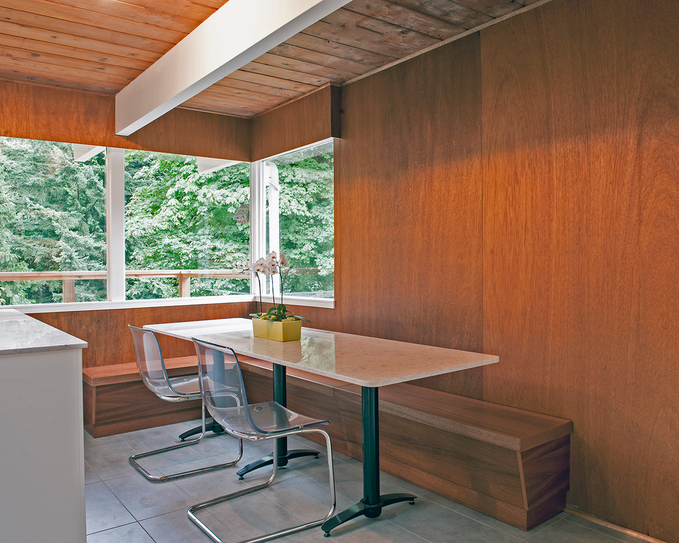 Mid-sized 1960s u-shaped ceramic tile eat-in kitchen photo in Vancouver with a drop-in sink, flat-panel cabinets, white cabinets, quartz countertops, black backsplash, subway tile backsplash and stainless steel appliances
