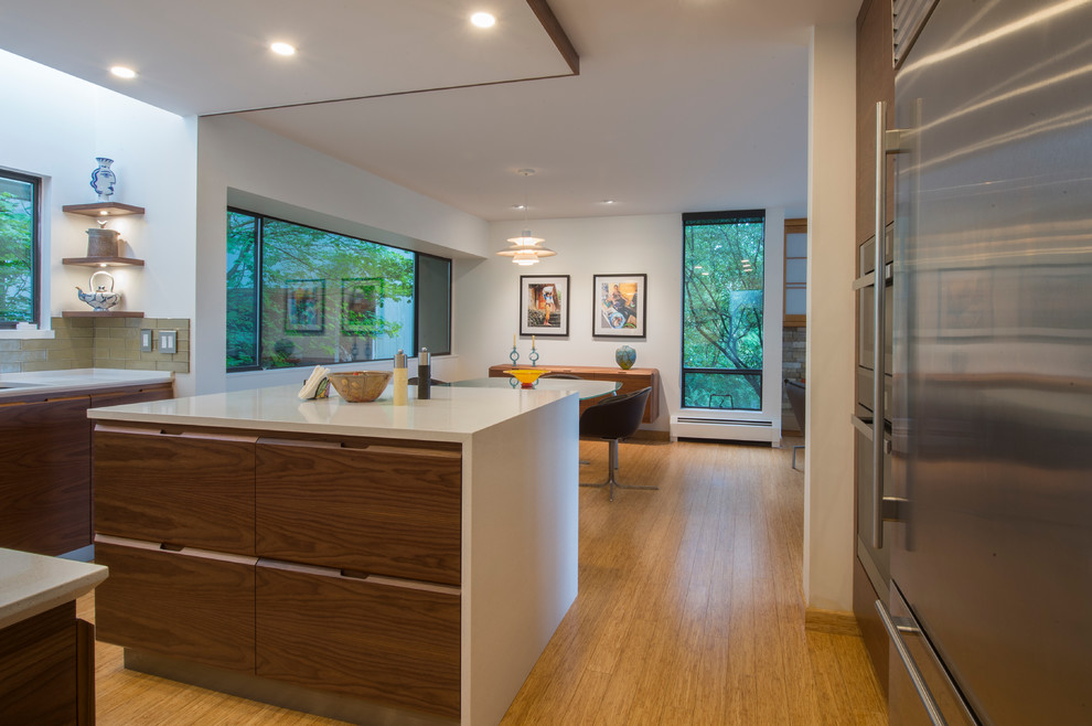 Inspiration for a mid-sized modern u-shaped bamboo floor and beige floor eat-in kitchen remodel in Vancouver with an undermount sink, flat-panel cabinets, dark wood cabinets, quartz countertops, green backsplash, glass tile backsplash, stainless steel appliances and an island