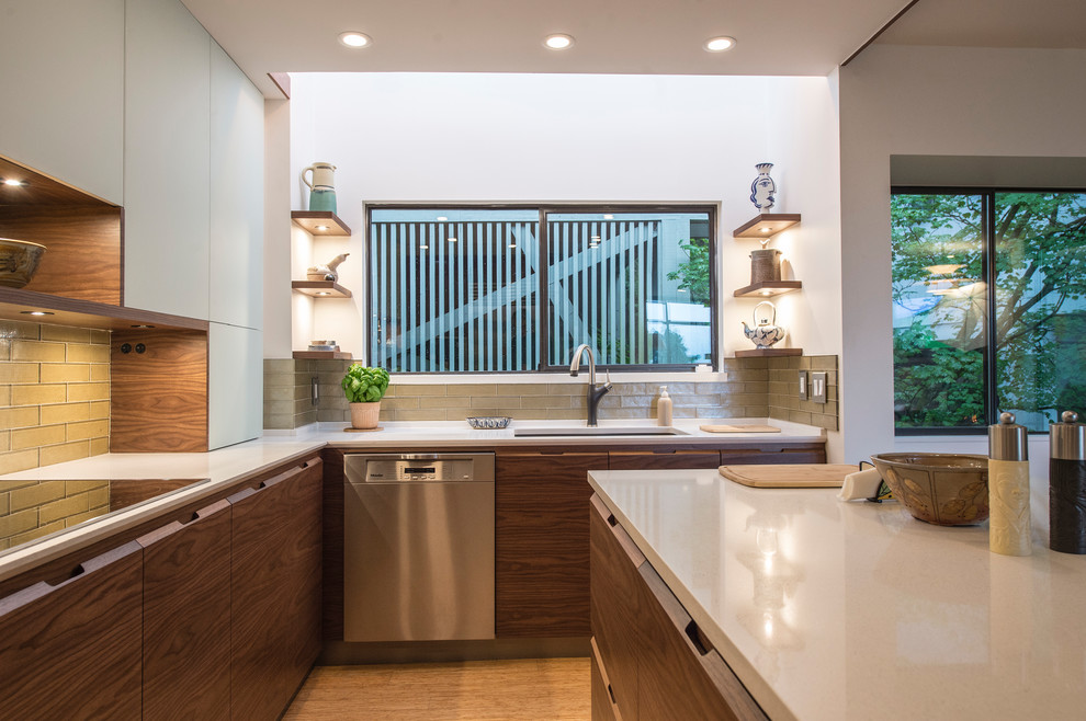 Example of a mid-sized minimalist u-shaped bamboo floor and beige floor eat-in kitchen design in Vancouver with an undermount sink, flat-panel cabinets, dark wood cabinets, quartz countertops, green backsplash, glass tile backsplash, stainless steel appliances and an island