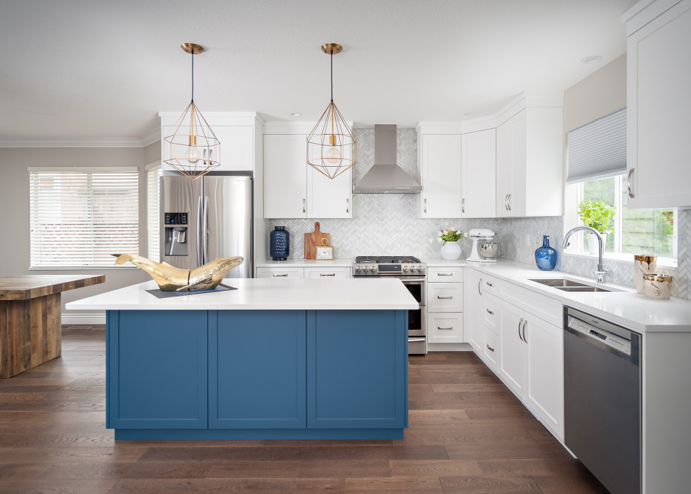 Inspiration for a mid-sized coastal l-shaped medium tone wood floor and brown floor eat-in kitchen remodel in Vancouver with an undermount sink, shaker cabinets, white cabinets, quartz countertops, white backsplash, marble backsplash, stainless steel appliances, an island and white countertops
