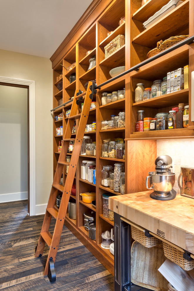 Example of a classic dark wood floor kitchen pantry design in Other with open cabinets and medium tone wood cabinets