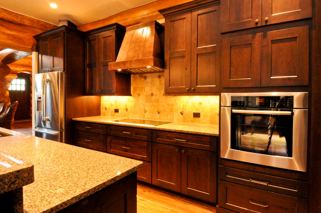 Western red cedar ranch style log home rustic kitchen for Western kitchen cabinets