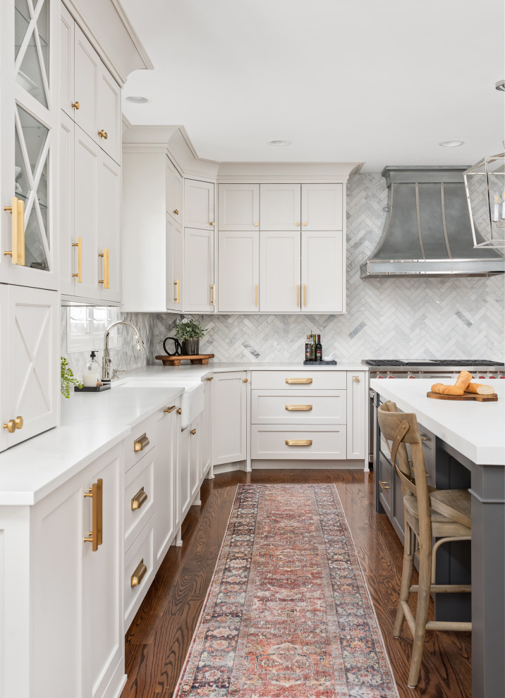 Large transitional u-shaped dark wood floor and brown floor open concept kitchen photo in Chicago with a farmhouse sink, recessed-panel cabinets, gray cabinets, quartz countertops, gray backsplash, marble backsplash, stainless steel appliances, an island and white countertops