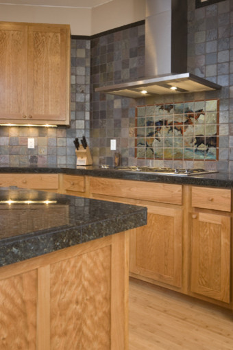Western tile mural in kitchen traditional kitchen for Traditional kitchen wall tiles