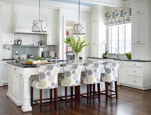 Modern style kitchen featuring a round floral style print on the bar stools and curtains