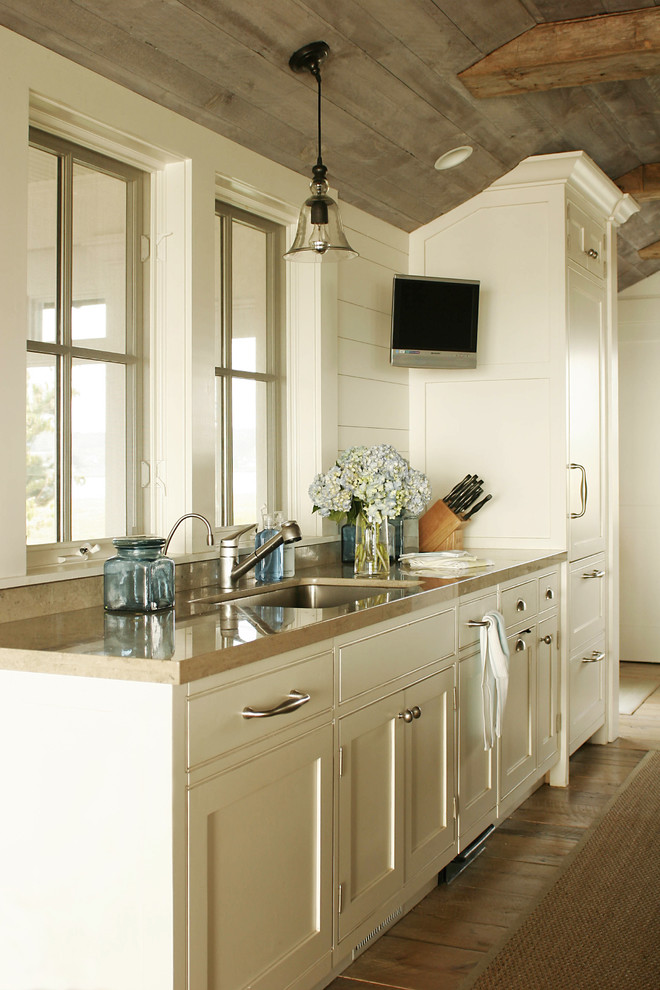 Large country galley medium tone wood floor eat-in kitchen photo in Bridgeport with a single-bowl sink, white cabinets, paneled appliances, no island and recessed-panel cabinets