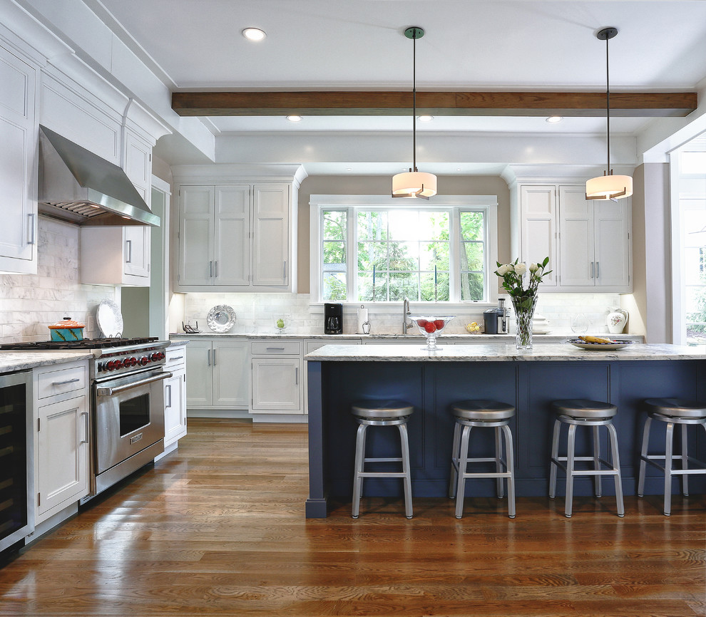 Kitchen - traditional kitchen idea in New York with recessed-panel cabinets, white cabinets, white backsplash and marble backsplash