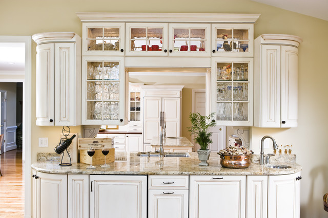 Wet bar with seeded glass cabinets allows light and openness to an