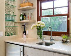 Wet Bar with tiled niche for glassware and floating shelves traditional media room