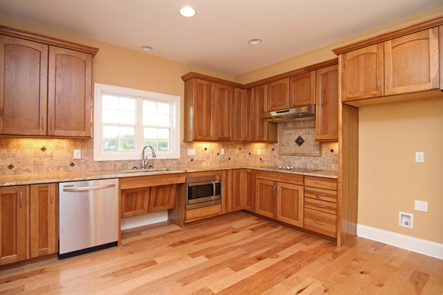 Wheelchair accessible kitchen features traditional for Accessible kitchen cabinets