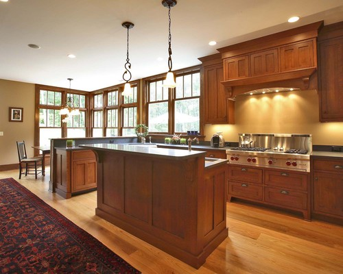 Love the combination of wood stain colors for the floor & cabinets ...